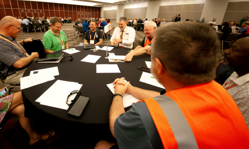 APWA chapter leaders discuss public works issues around the table